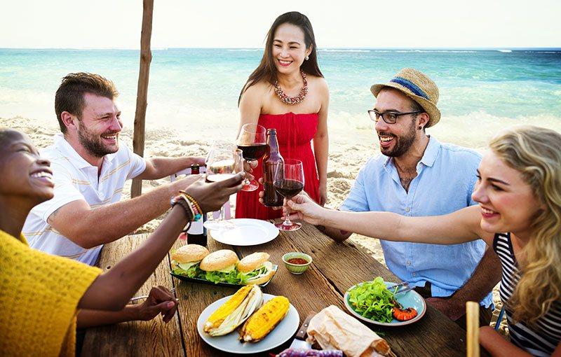 people dining on beach