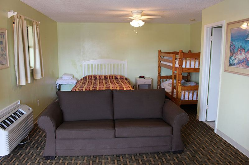 room with sofa and bunk beds