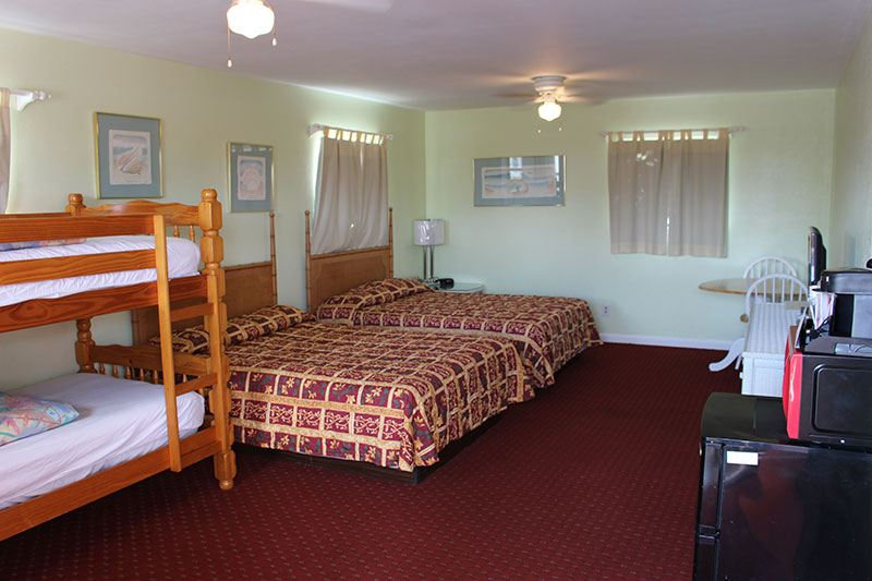 hotel room with two beds and bunk beds